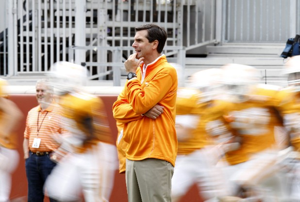 Coach Derek Dooley watches his players take the field for a skirmish in April.