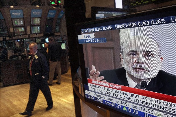 In a Feb. 2, 2012 file photo Federal Reserve Chairman Ben Bernanke's testimony before the House Budget Committee is visible on a television screen on the floor of the New York Stock Exchange. The Federal Reserve appears to be moving toward announcing some new step to try to energize the troubled U.S. economy. (AP Photo/Richard Drew, file)