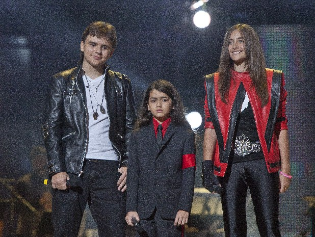 "In this Oct. 8, 2011 file photo, from left, Prince Jackson, Prince Michael II ""Blanket"" Jackson and Paris Jackson arrive on stage at the Michael Forever the Tribute Concert, at the Millennium Stadium in Cardiff, Wales. TJ Jackson, one of Michael's favorite nephews, has been designated to work beside Michael's mother, Katherine, to look after the welfare of his three cousins Prince, 15, Paris, 14 and Blanket,10, who will inherit the King of Pop's fortune."