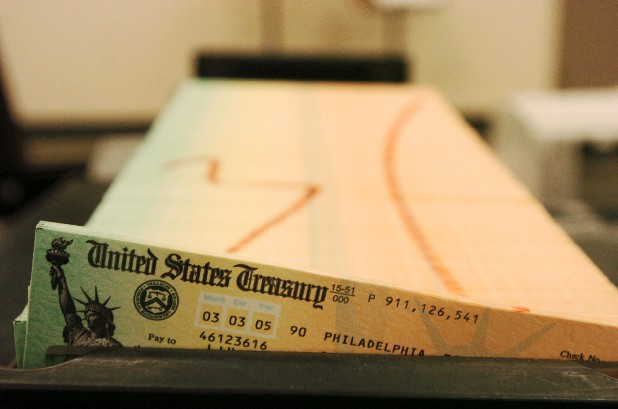 This February 2005 file photo shows trays of printed social security checks, in Philadelphia, waiting to be mailed from the U.S. Treasury. People retiring today are part of the first generation of workers who have paid more in Social Security taxes during their careers than they will receive in benefits after they retire. It's a historic shift that will only get worse for future retirees, according to an analysis by The Associated Press. Previous generations got a much better bargain, mainly because payroll taxes were very low when Social Security was enacted in the 1930s and remained so for decades.