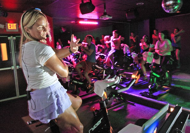 Anna Mercer, left, leads the adults-only Raunchy Ride spin class at Thrive Studio.