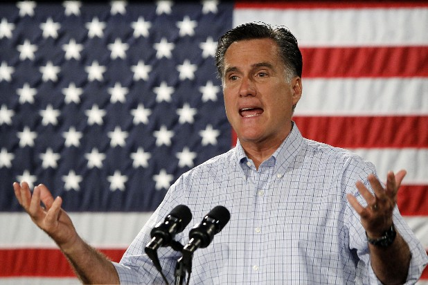 Republican presidential candidate Mitt Romney campaigns at Central Campus High School in Des Moines, Iowa, Wednesday.