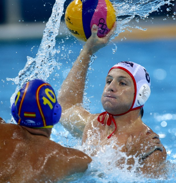 Spain's Felipe Perrone Rocha, left, puts his hand on United States' Tony Azevedo while defending during a men's semifinal fifth to eighth place water polo match at the 2012 Summer Olympics, Friday, Aug. 10, 2012, in London.