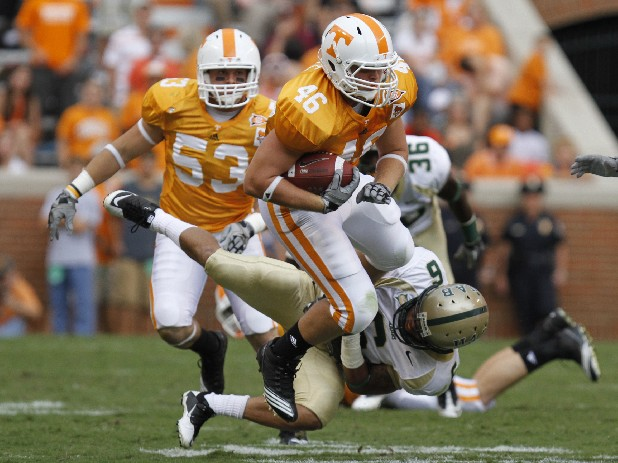 Vols fullback Channing Fugate, No. 46, tries to shake off UAB safety Justin Smartt, No. 6, in this file photo.