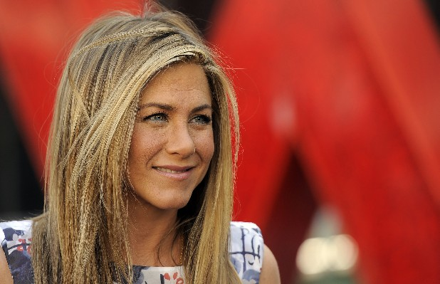 This Feb. 23, 2012 file photo shows actress Jennifer Aniston after a ceremony to award her a star on the Hollywood Walk of Fame in Los Angeles. Aniston is ready to marry again. The actress is engaged to screenwriter and actor Justin Theroux, Aniston's rep, Stephen Huvane, confirms, Sunday, Aug. 12, 2012. (AP Photo/Chris Pizzello, file)