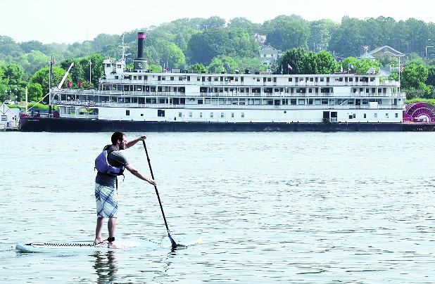 Josh Riley paddleboards on the Tennessee River Saturday afternoon.