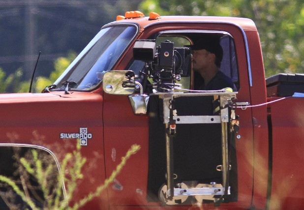"Tim McGraw drives a large pickup truck while shooting a video for what is expected to be his new song ""Truck Yeah"" at the former U.S. Pipe foundry in Chattanooga on Tuesday. According to Lisa Wheelous, a location scout and manager from Chattanooga, McGraw's is including over 50 local extras and used Craigslist to acquire monster pickup trucks."