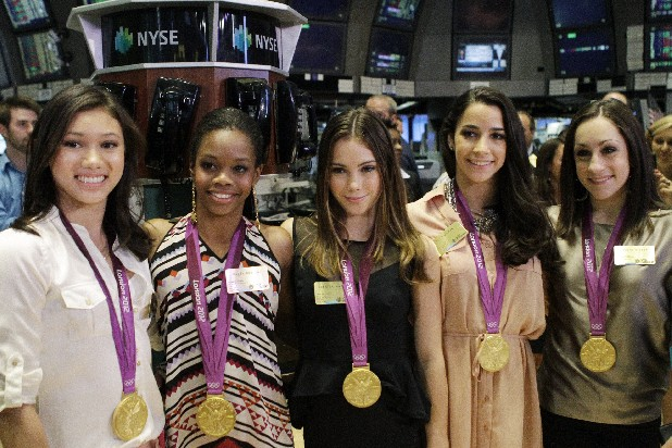From left, Kyla Ross, Gabby Douglas, McKayla Maroney, Aly Raisman, and Jordyn Wieber, members of the United States women's Olympic gymnastics gold medal-winning team, pose for photos on the floor of the New York Stock Exchange, Tuesday, Aug. 14, 2012, in New York. (AP Photo/Alex Katz)