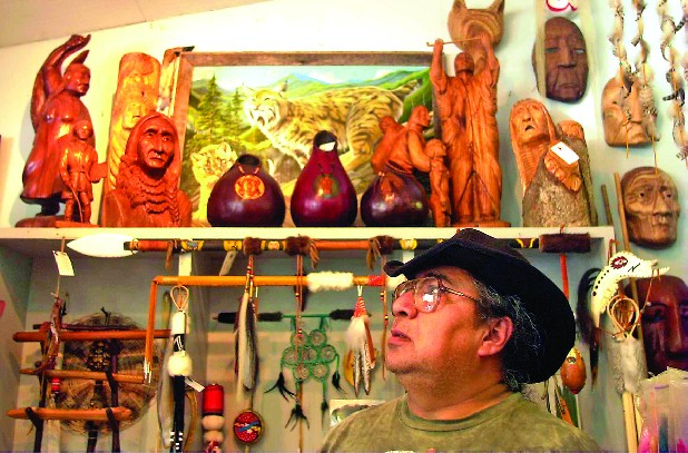 Danny Walkingstick stands inside of Medicine Man Crafts, a Native American crafts store located in Cherokee, North Carolina.  Mr. Walkingstick and his wife sell items that they make to the store.