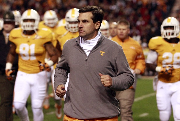 UT's head coach Derek Dooley takes the field in this file photo.