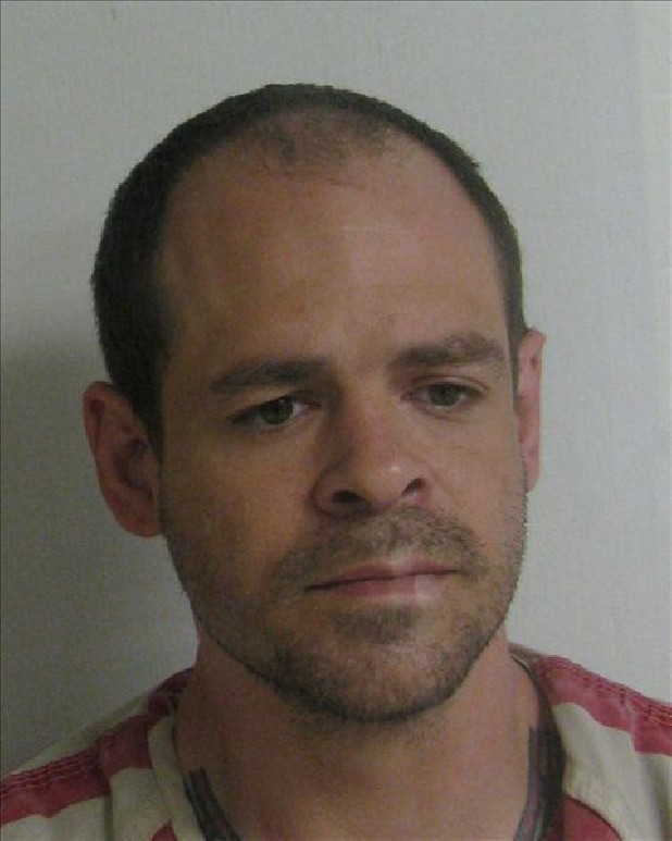 Jason Paul Baker, 32, of Riceville, Tenn., is charged with first-degree murder in the shooting and stabbing death of longtime Calhoun, Tenn., volunteer firefighter Dennis Patterson.