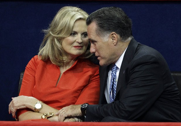 U.S. Republican presidential nominee Mitt Romney sits with his wife Ann after she addressed the Republican National Convention in Tampa, Fla., on Tuesday, Aug. 28, 2012.