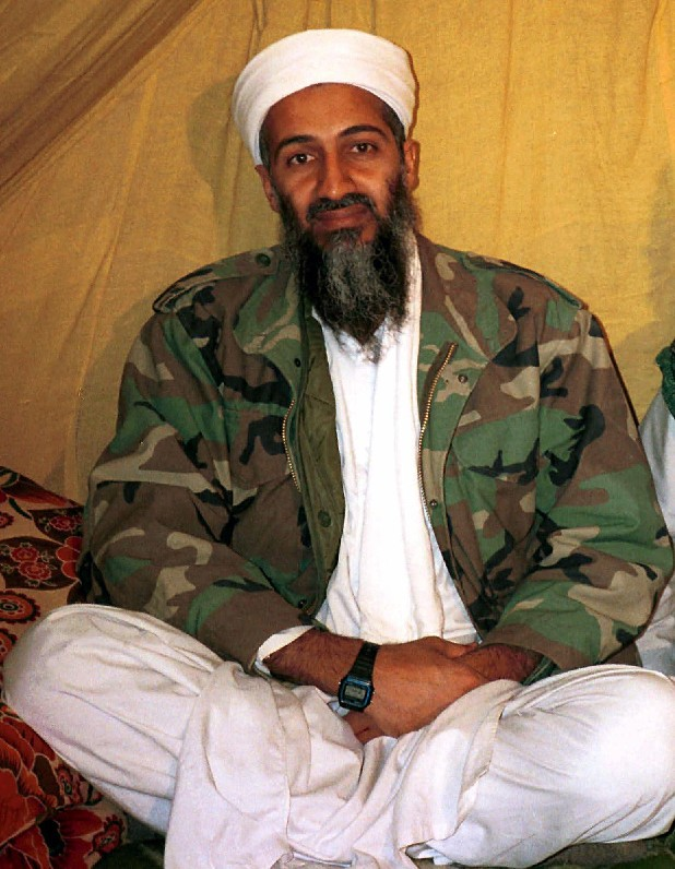 Al Qaida leader Osama bin Laden is shown in Afghanistan. A firsthand account of the Navy SEAL raid that killed Osama bin Laden contradicts previous accounts by administration officials, raising questions as to whether the terror mastermind presented a clear threat when SEALs first fired upon him.
