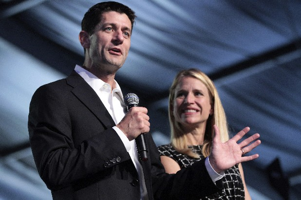 Republican vice presidential candidate Rep. Paul Ryan, R-Wis., and wife, Janna, appear on stage at the Wisconsin delegation's Beers and Brats event on Wednesday in Tampa, Fla.
