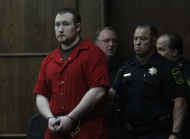 Jesse Mathews is escorted into Judge Barry Steelman's courtroom Thursday afternoon. Mathews is charged with killing Chattanooga police Sgt. Tim Chapin during a botched robbery in April 2011.