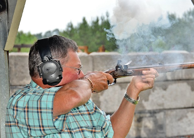 Bob Wilson, a retired history teacher, fires his muzzleloader on the range at Camp Shooters Inc. in Chatsworth, Ga. Wilson can fire up to three rounds per minute. He puts the solid lead balls in his mouth and then spits them into the rifle barrel after pouring black powder down it.