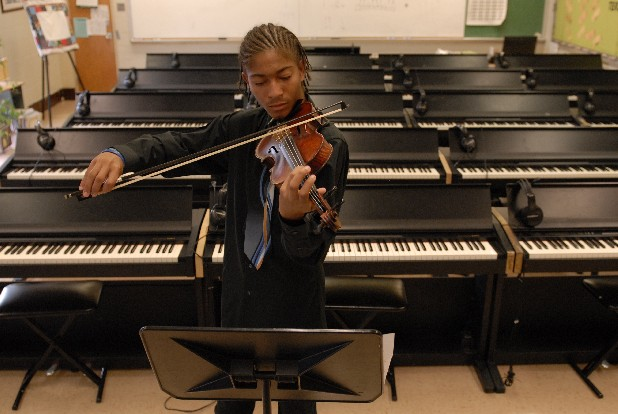 Chattanooga School for the Arts and Sciences junior Chandler Custer rehearses a piece at the Center for Creative Arts for his sister's wedding on Tuesday, August 28. Custer is the concert master of the CSAS symphonic orchestra, the second chair first violinist in the CSO Youth Orchestra and a competitive tennis player.