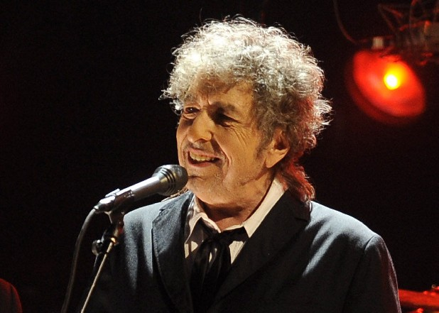 In this Jan. 12, 2012 file photo, Bob Dylan performs in Los Angeles. Fifty years into his career as a recording artist and a week away from release of an extraordinary new CD, Dylan spent his Tuesday evening where he seems to feel most comfortable — on a stage. (AP Photo/Chris Pizzello, File)