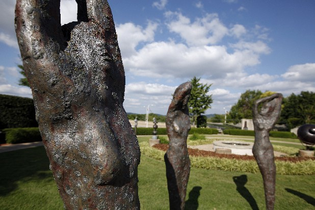 Three sculptures by artist Mark Chatterly decorate the sculpture garden of the Bluff View Art District.