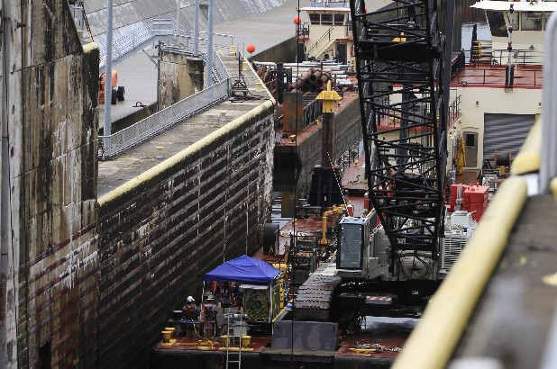 Construction continues on the dewatered Chickamauga Lock to repair issues including binding hinges on the downstream main gates, spot welding cracks in metal hardware, gasket replacement, and other necessities to allow the waterway to continue operating safely.