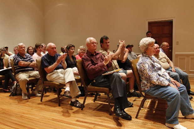 Audience members applaud a statement made against the proposed tax hike during the open forum portion of a Rossville City Council meeting held in the Judge Paul W. Johnny Painter Court Room in Rossville on Monday. Council members voted to table the vote on the proposed budget until the next regular council meeting.