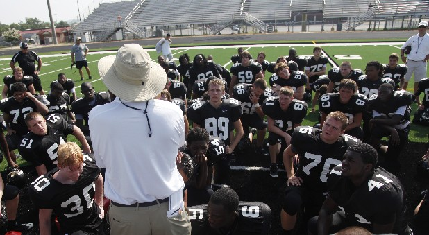 Coach Mark Mariakis addresses his players after practice at Ridgeland High School.