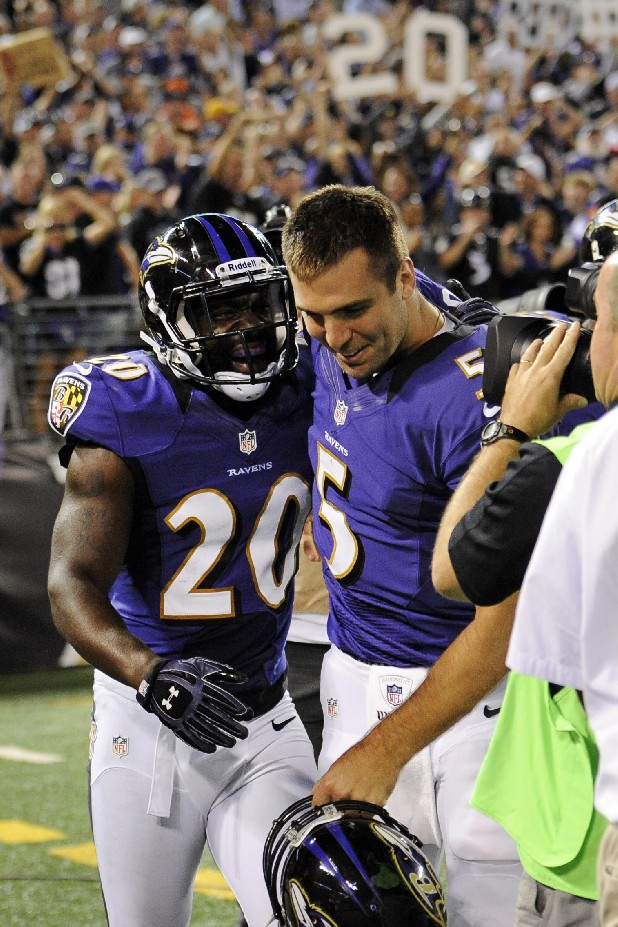 Baltimore Ravens free safety Ed Reed (20) celebrates his touchdown on an interception with quarterback Joe Flacco in the second half of an NFL football game against the Cincinnati Bengals in Baltimore, Monday, Sept. 10, 2012. Baltimore won 44-13.