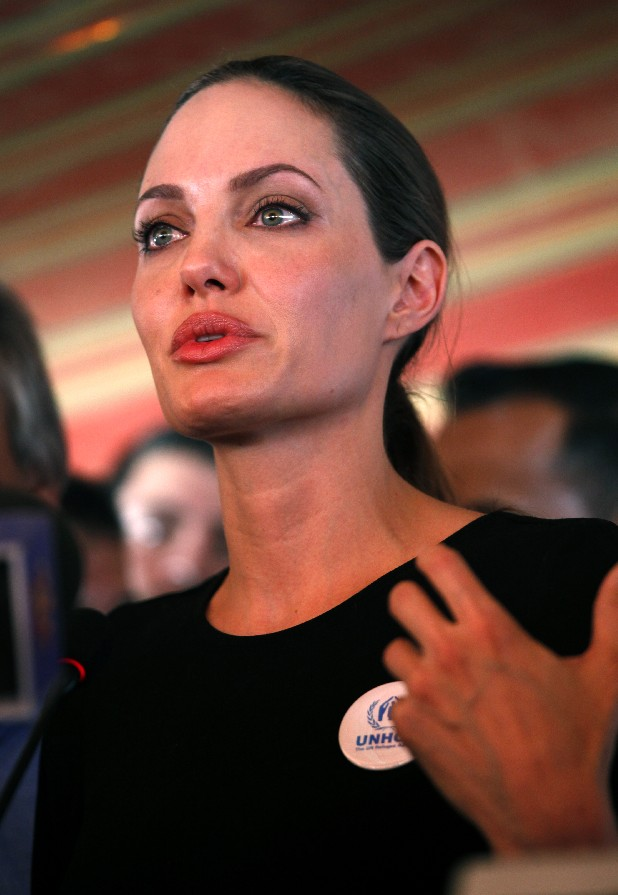 The U.N. refugee agency's special envoy, actress Angelina Jolie, speaks to the press during her visit to the Zaatari Syrian Refugees Camp, in Mafraq, Jordan, Tuesday, Sept. 11, 2012. The Hollywood star arrived on this morning in the Zaatari camp, which hosts about 27,000 Syrians displaced by the 18-month conflict. (AP photo/Mohammad Hannon)
