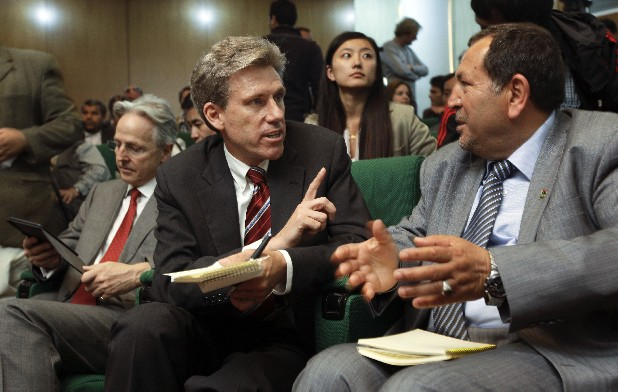In this Monday, April 11, 2011 file photo, U.S. envoy Chris Stevens, center, accompanied by British envoy Christopher Prentice, left, speaks to Council member for Misrata Dr. Suleiman Fortia, right, at the Tibesty Hotel where an African Union delegation was meeting with opposition leaders in Benghazi, Libya. Libyan officials say the U.S. ambassador and three other Americans have been killed in an attack on the U.S. consulate in the eastern city of Benghazi by protesters angry over a film that ridiculed Islam's Prophet Muhammad. The officials say Ambassador Chris Stevens was killed Tuesday night when he and a group of embassy employees went to the consulate to try to evacuate staff. The protesters were firing gunshots and rocket propelled grenades.