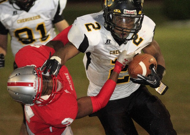 McMinn County High School's Dre Sanders (2) plows over Ooltewah High School's Shawn Montgomery (9) during the first half of play Friday evening at the Owl's home field.