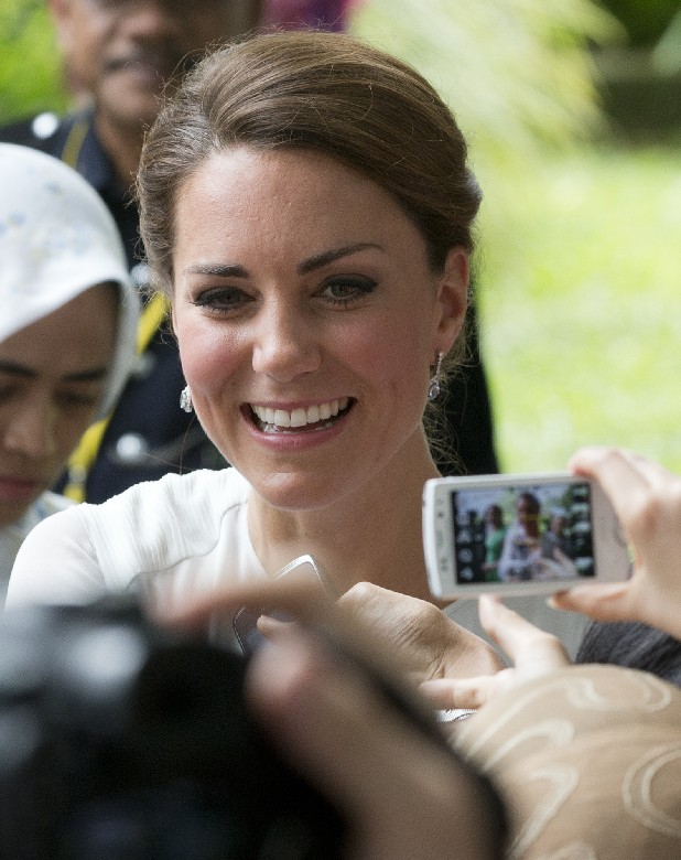 Kate, the Duchess of Cambridge shakes hands with well-wishers.
