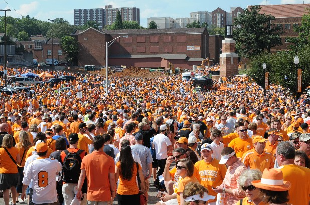 Thousands of fans crowd Phillip Fulmer Way before the start of Saturday's SEC game with Florida.
