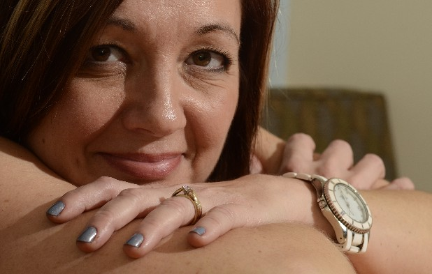 Pam Patton's fingernails are painted with the OPI polish called I Don't Give a Rotterdam, a shade of gray similar to the one worn by Michelle Obama as she delivered her speech at the Democratic National Convention earlier this month.