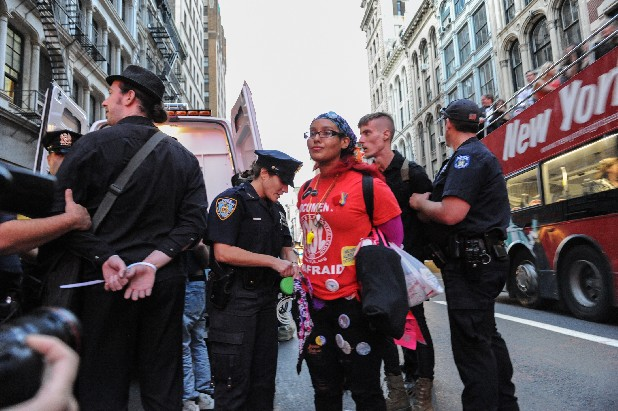 "A group of people associated with the Occupy"" movement march is arrested on a march down Broadway in New York enroute to Zuccotti Park, Saturday, Sept. 15, 2012. Monday, Sept. 17, 2012 marks the one year anniversary of the Occupy movement."