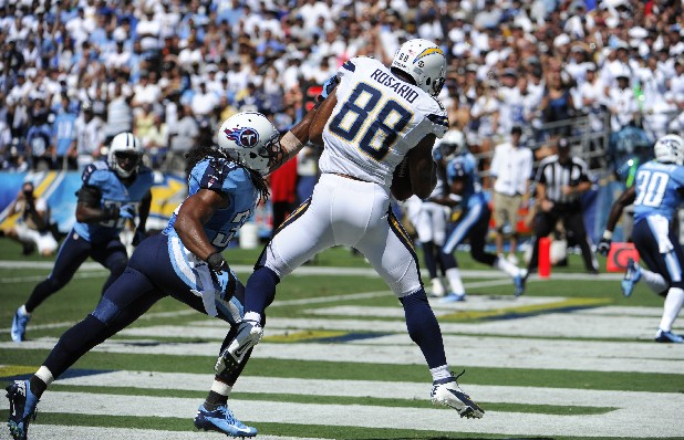 San Diego Chargers tight end Dante Rosario makes a touchdown catch as Tennessee Titans free safety Michael Griffin defends during the first quarter of an NFL football game Sunday, Sept. 16, 2012, in San Diego.