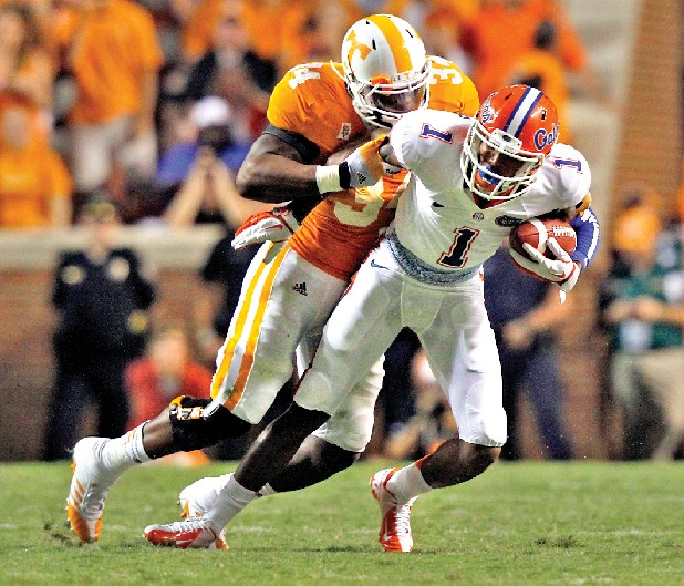 Florida Gators wide receiver Quinton Dunbar (1) is tackled by Tennessee Volunteers linebacker Herman Lathers (34) in the fourth quarter of an NCAA college football game on Saturday, Sept. 15, 2012, in Knoxville, Tenn. (AP Photo/Wade Payne)