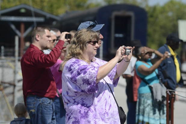 Brenda Bogart, center, from Pennsylvania, takes photos of the turntable in action at the Tennessee Valley Railroad Museum.