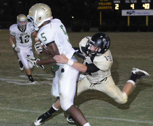Notre Dame's Ricky Ballard (5) is tackled by Lookout Valley defender Vann Scribner (13) in a 7-7, first half tie Friday at Lookout Valley. Taylor Bankston (12), left, pursues on the play.