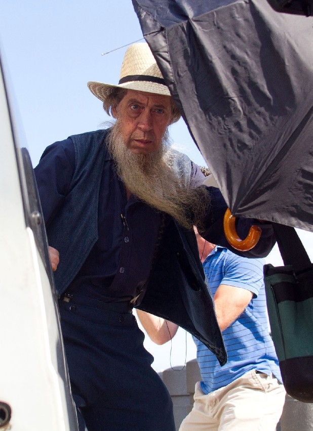 An Amish man boards his transportation vehicle outside the U.S. Federal Courthouse in Cleveland on Thursday, Sept. 20, 2012. The jury found all 16 Amish people guilty in the hair- and beard-cutting attacks against fellow Amish in Ohio. (AP Photo/Scott R. Galvin)