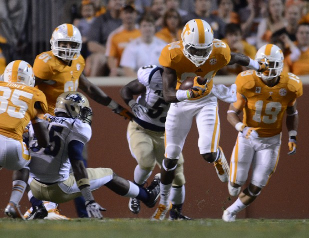 UT's Cordarrelle Patterson carries against Akron Saturday at Neyland Stadium.