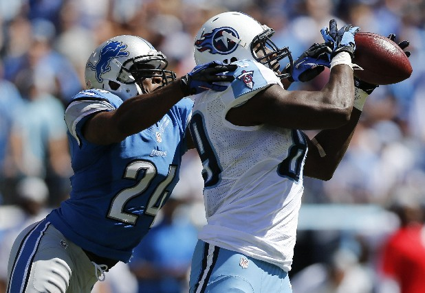Tennessee Titans tight end Jared Cook (89) catches a touchdown pass as he is defended by Detroit Lions strong safety Erik Coleman (24) in the second quarter of an NFL football game on Sunday, Sept. 23, 2012, in Nashville.