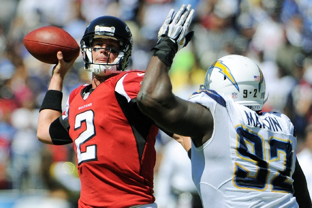 Atlanta Falcons quarterback Matt Ryan (2) throws under pressure by San Diego Chargers defensive end Vaughn Martin during the first half of an NFL football game in San Diego, Sunday, Sept. 23, 2012.
