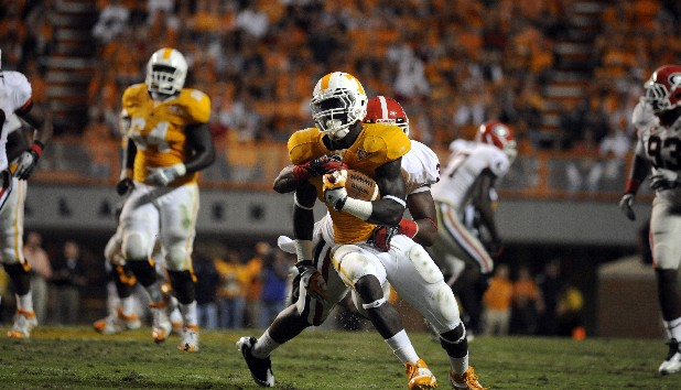 Tennessee's Marlin Lane runs the ball as Georgia's Michael Gilliard chases him in last year's 20-12 victory for the visiting Bulldogs. Lane led the Vols rushing attack with 8 yards.