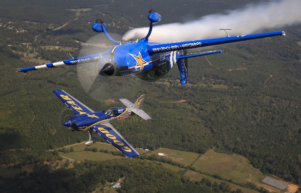 Pilots with the Air National Guard Aerobatic Team and Goodyear Aviation practice an inverted flight formation Wednesday above the Richard B. Russell Regional Airport in Rome, Ga., in preparation for this weekend's Wings Over North Georgia Air Show.