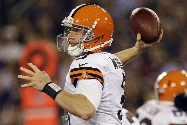 Cleveland Browns quarterback Brandon Weeden passes during the first half of an NFL football game against the Baltimore Ravens in Baltimore, Thursday, Sept. 27, 2012.