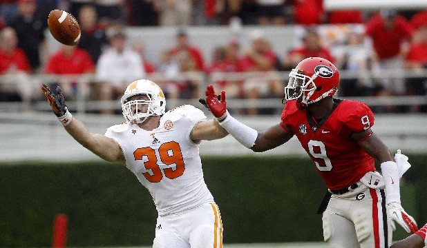 Georgia linebacker Alec Ogletree (9 breaks up a pass intended for Tennessee fullback Ben Bartholomew (39) during the first half of an NCAA college football game Saturday, Sept. 29, 2012, in Athens, Ga. Georgia won 51-44.