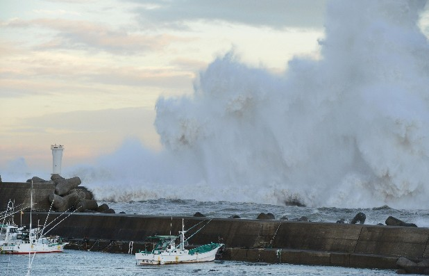 High waves hit a breakwater in Kihocho, Mie prefecture, western Japan Sunday, Sept. 30, 2012. A powerful typhoon is heading to Tokyo after injuring dozens of people, causing blackouts and paralyzing traffic in southern Japan. (AP Photo/Kyodo News)