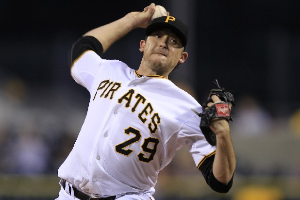 Pittsburgh Pirates starting pitcher Kevin Correia (29) delivers during the first inning of a baseball game against the Atlanta Braves in Pittsburgh Tuesday, Oct. 2, 2012. The Pirates won 5-1, with Correia getting his 12th win of the season.