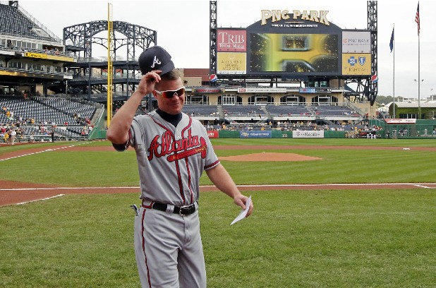 Altanta Braves Chipper Jones walks to the dugout after presenting the lineup card before a baseball game against the Pittsburgh Pirates at PNC Park in Pittsburgh Wednesday, Oct. 3, 2012.