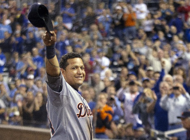 Detroit Tigers' Miguel Cabrera waves to the crowd after being replaced during the fourth inning of a baseball game against the Kansas City Royals at Kauffman Stadium in Kansas City, Mo., Wednesday, Oct. 3, 2012. Cabrera achieved baseball's first Triple Crown since 1967 by leading the league with a .330 average, 44 home runs and 139 RBIs in the regular season.